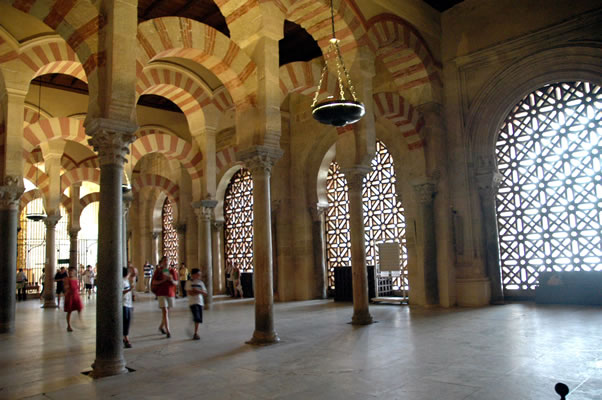 Arches of Mosque of Cordoba leading to Orange Tree Courtyard - light filters through semi transparent materials.