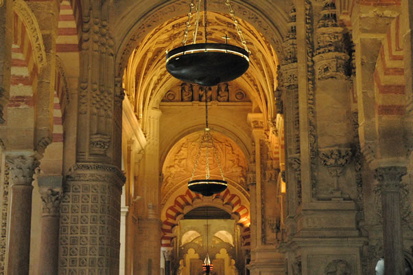 A mix of architectural styles in the Cordoba Cathedral's central aisle.