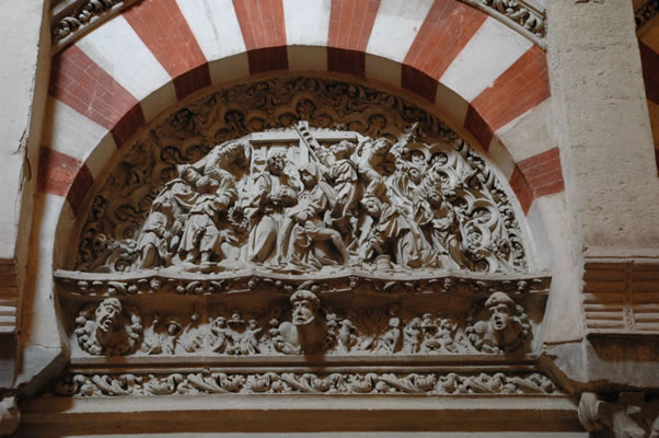 Pieta relief under Islamic arch in Mosque-Cathedral of Cordoba